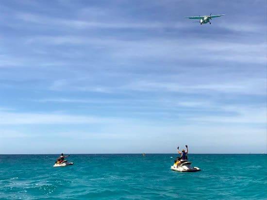 airplane landing maho beach wave runner tours